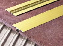 Ploche podlahové přechodové lišty