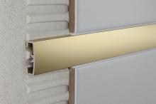 Lišta do obkladů dekorační dělící AL eloxovaný zlatý 25 mm, 2,7 m